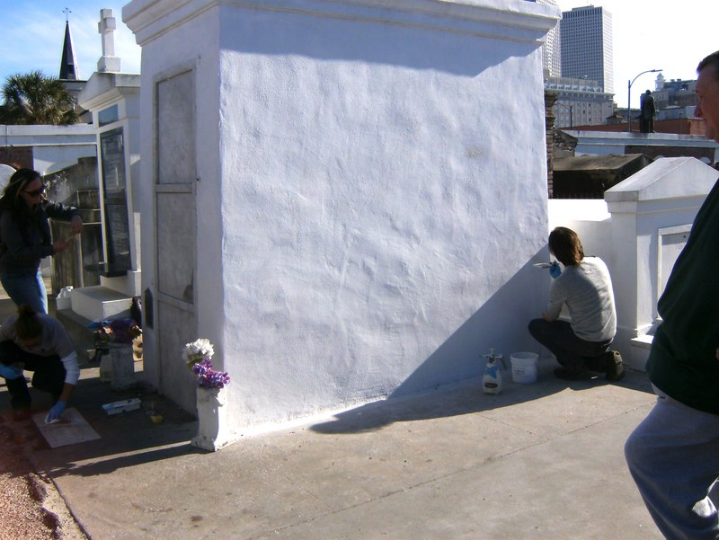 Marie Laveau's Grave being restored by the caretakers at the St Louis Cemetery in New Orleans
