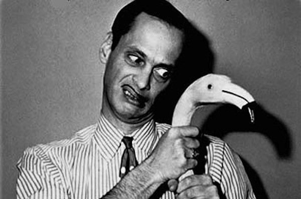 John Waters with pink flamingo
