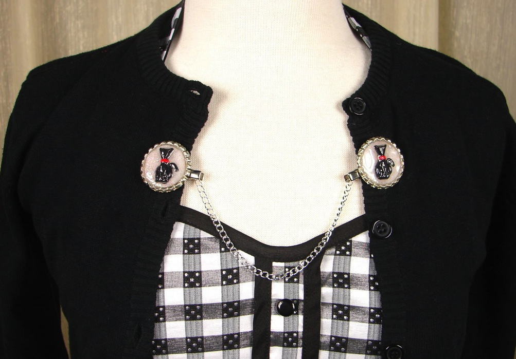 Keep your sweater on, kitten! Lil' Darlin Accessories' Shadow Kitty Sweater Clips