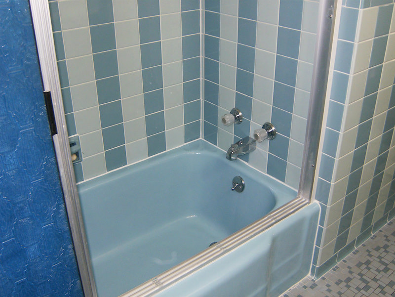 A retro renovation, save the bue bathroom. Tiled bathtub area