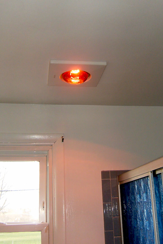 A retro renovation, save the bue bathroom. Heat lamp.