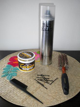 Soft bristle brush-I like to use the soft bristles to smooth the rolls out. Rat tail comb-For teasing when needed. Pomade or a smoothing finishing cream-I steal my hubbys Layrite. Hair spray-I like it strong, like my coffee! Bobby pins-Pick closest your your hair color.