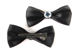 Black Diamond Bow Set by Graveside Looks has a nice metal clip that makes  for easy placement on the hair. The beautiful rhinestone detail with make those Victory Rolls shine.