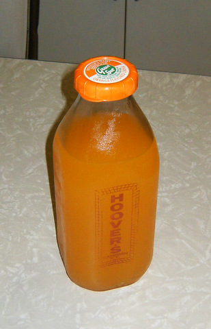 Green Spot Orange drink in a dairy bottle