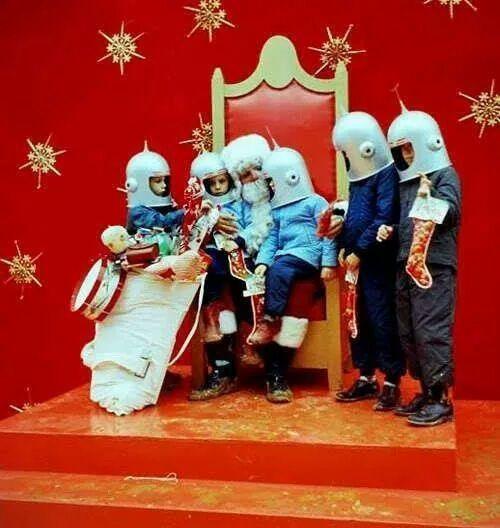 retro christmas santa and kids dressed as space men