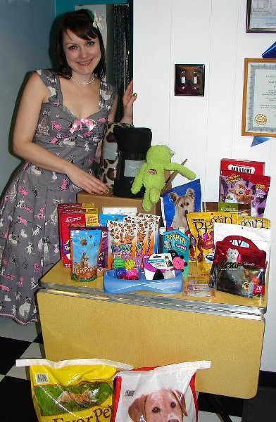 Julie Ann and all the cat treats donated for the Cats Like Treats Event